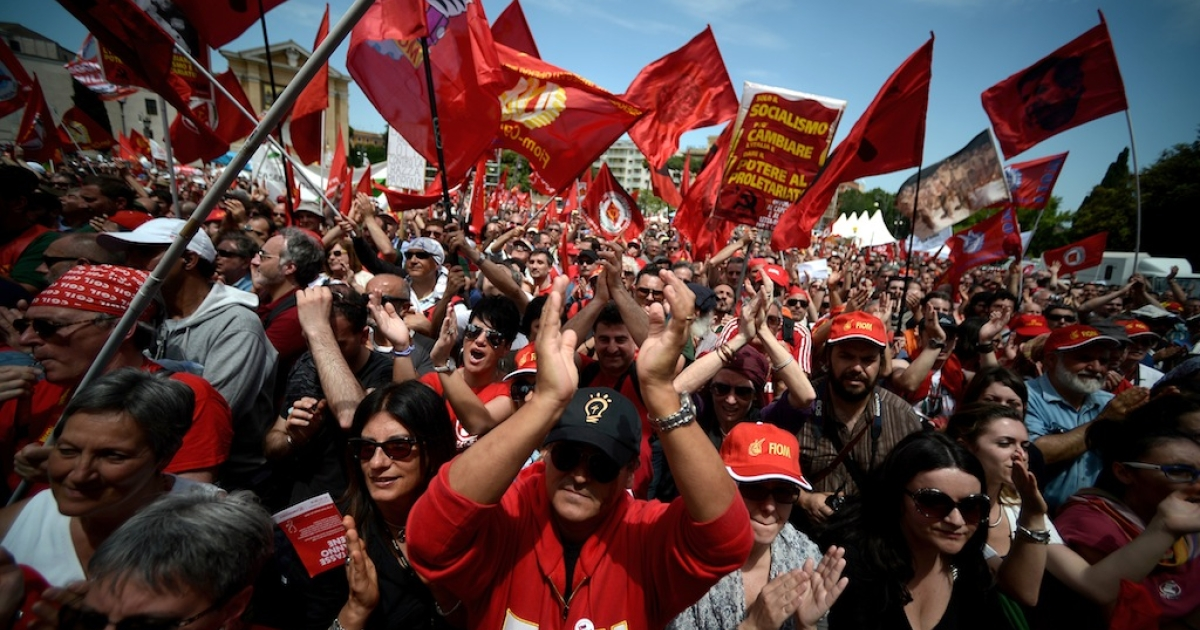 Demonstrators applaud during the left-wing Italian metalworkers' union FIOM rally in downtown Rome Piazza San Giovanni on May 18, 2013.</p>
