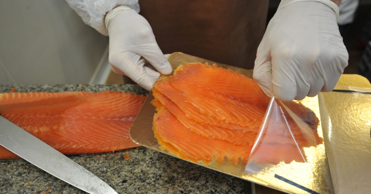 A worker packages slices of salmon on Nov. 23, 2011 at a salmon factory in Quiberon, western France.</p>