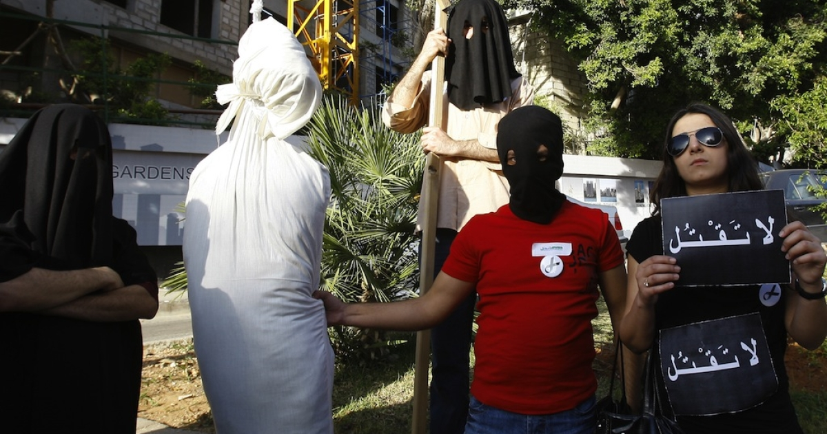 Lebanese human rights activists protest against capital punishment outside the Saudi embassy in Beirut on April 1, 2010.</p>
