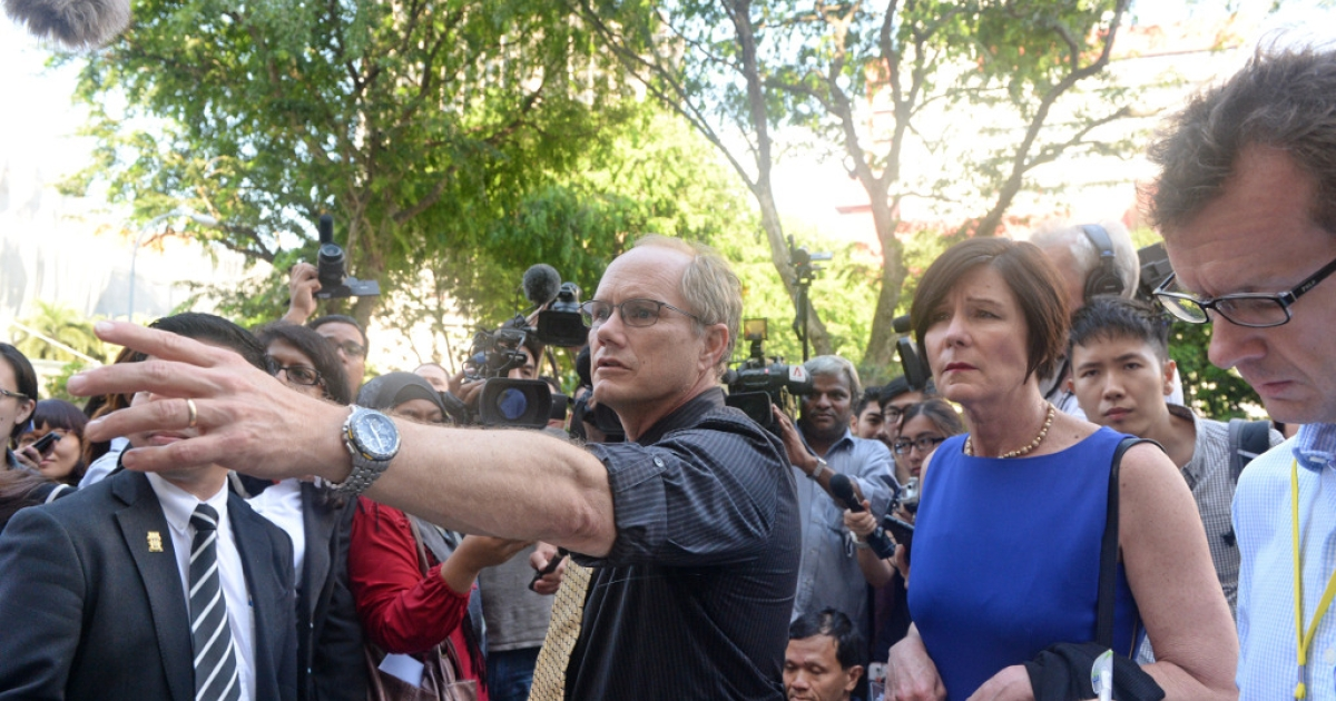 Rick Todd and his wife Mary talk to reporters outside the Subordinate courts in Singapore on May 13, 2013. Singapore launched a public inquiry into the death of a Shane Todd whose family believes he was murdered because of a high-tech project for a Chinese firm that has been suspected of espionage.</p>
