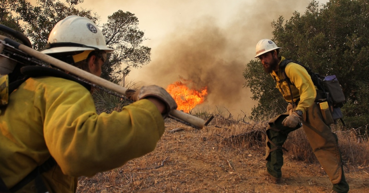 CAMARILLO, CA - MAY 3:  Firefighters with the Type 1 Interagency Hotshot Crew (IHC), based out of the Lone Peak Conservation Center, in Draper, Utah, build a fire break as the Springs fire continues to grow on May 3, 2013 near Camarillo, California.</p>