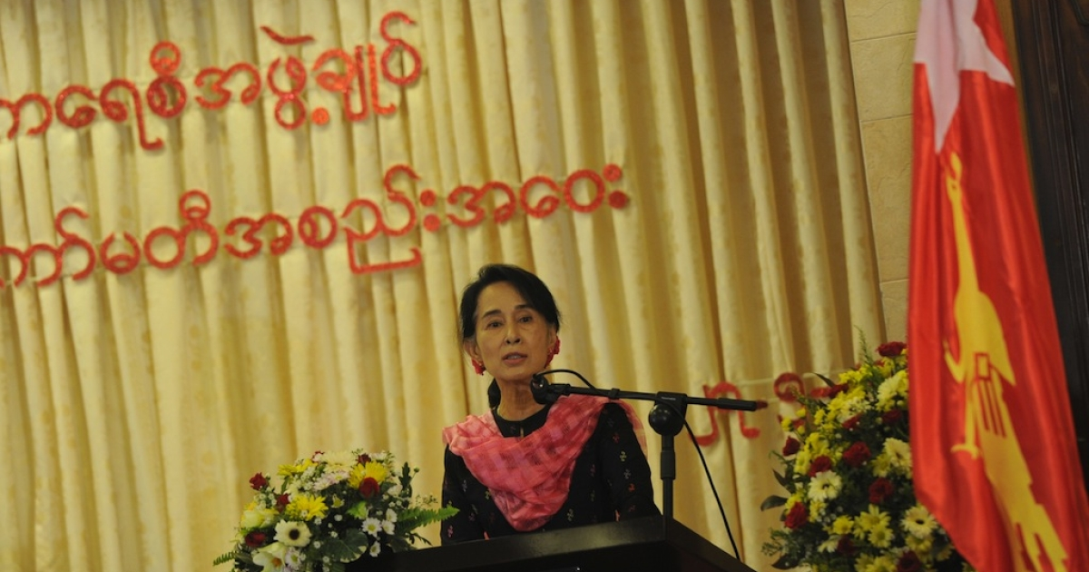 Aung San Suu Kyi delivers a speech during the first National League for Democracy (NLD) Central Executive Committee meeting in Yangon on May 27, 2013.</p>