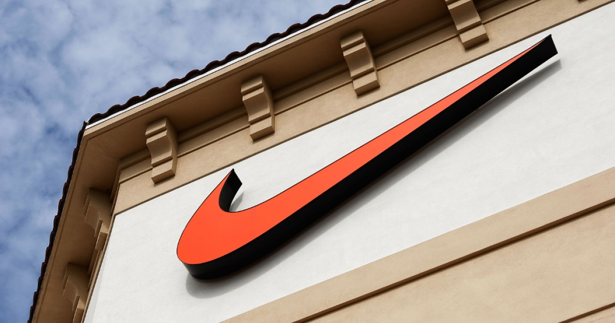 The 'Swoosh' logo is seen on a Nike factory store on December 12, 2009 in Orlando, Florida.</p>