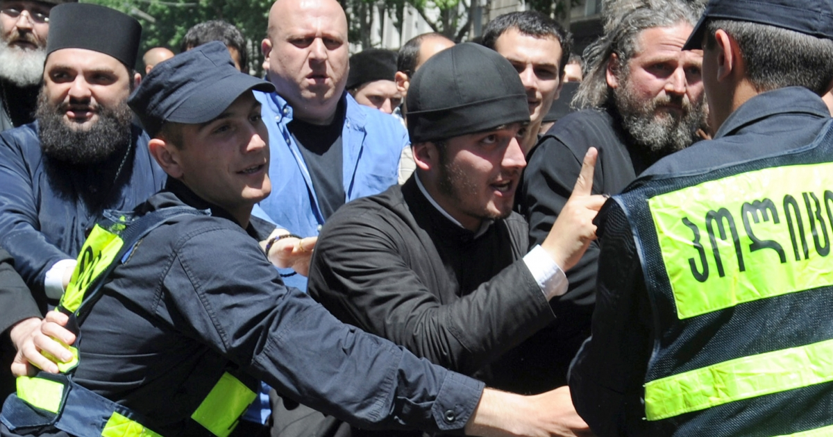 Orthodox believers confront police during a gay rights rally in Tbilisi last week.</p>