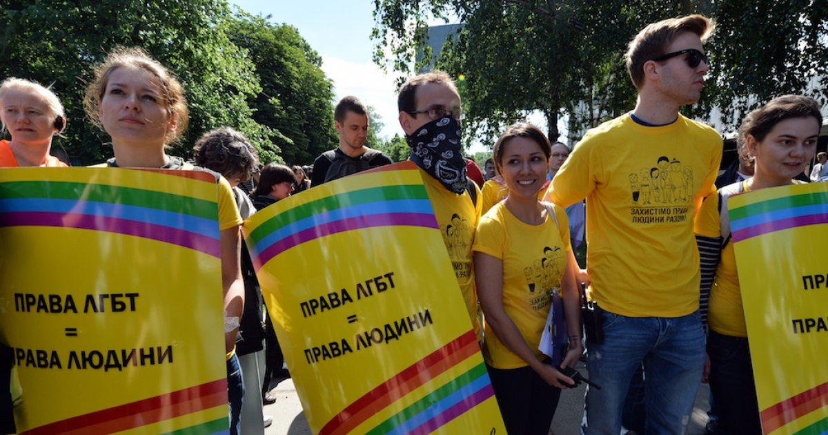 Activists carry placards reading 'LGB rights are human rights' during the Gay Parade in Kiev on May 25, 2013.</p>