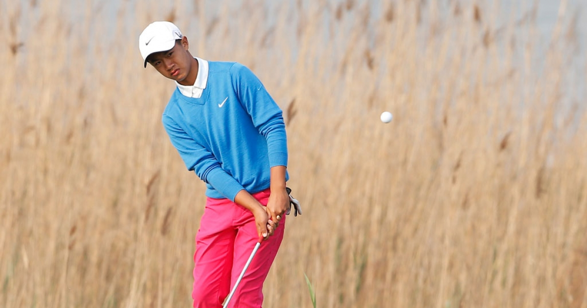 Ye Wocheng of China plays a shot during the second day of the Volvo China Open at Binhai Lake Golf Course on May 3, 2013 in Tianjin, China. He's the youngest to ever play on the European Tour.</p>