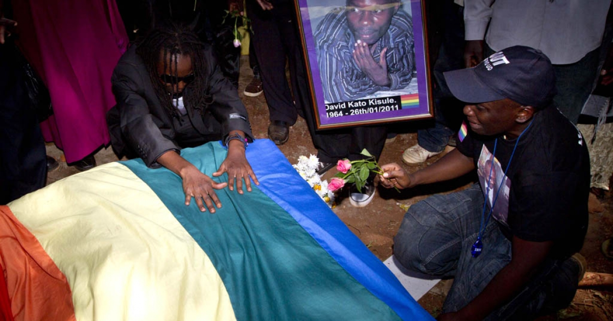 Members of the Ugandan gay community attend a funeral of murdered activist David Kato, at his parental home close to the town of Mataba on January 28, 2011. Although the police claims it was most likely a petty crime, targeting Kato's money, many members of the gay and the human rights community hold the Ugandan government responsible for not battling the growing resentments against homosexuals in the Ugandan society. Homosexuality is illegal in many African countries and is punishable by a prison sentence.</p>