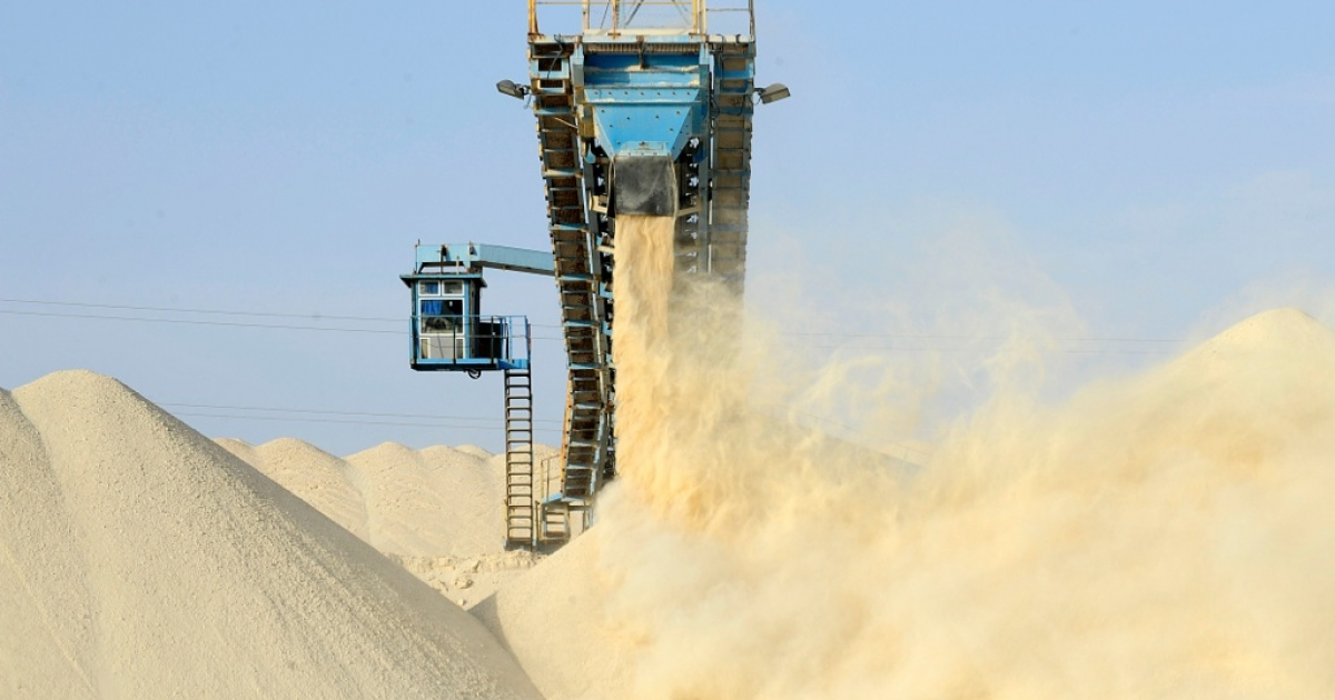 A picture taken on May 13, 2013 shows untreated phosphate being dropped off the end of a conveyor belt at the national Moroccan phosphates company's Marca factory.</p>