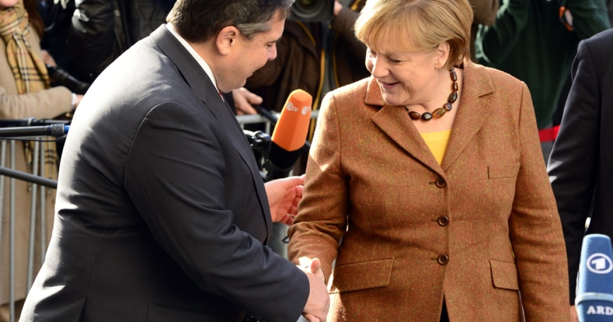 German Chancellor Angela Merkel shakes hands with Sigmar Gabriel, leader of Germany's social democratic SPD party. Merkel's conservative CDU/CSU union and the SPD agreed the terms of a coalition pact on November 27, 2013.</p>