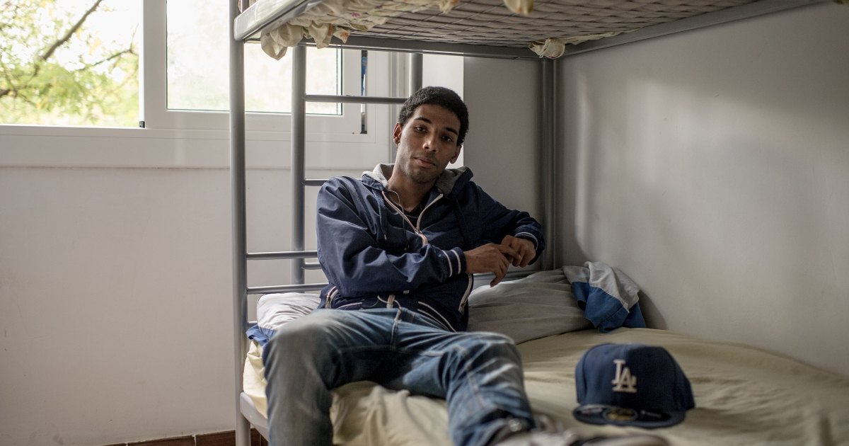 Eduardo Cordero, 19, from the Dominican Republic poses for a portrait in his room shared with his brother in the family apartment. Eduardo arrived in Spain in 2011 with his family.  He was working without a contract until June, when he was fired, and is now seeking a job through the Exit Foundation. According to the latest Spanish National Institute of Statistics (INE) figures the new youth unemployment rate is 54.37 percent, reaching 79 percent among those 20 to 24 years old.</p>