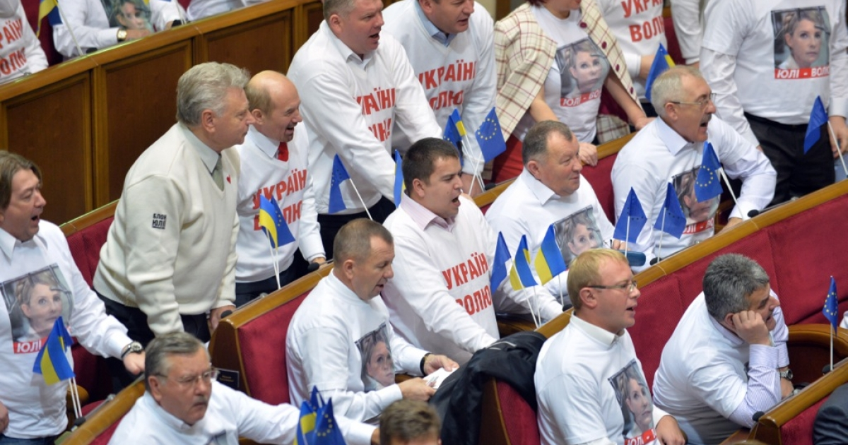 Ukrainian opposition lawmakers wore pictures of Yulia Tymoshenko during a parliamentary session on the bill that would allow the release of the jailed ex-premier at the parliament in Kiev, on November 13, 2013. The session ended without a vote, putting the future of Ukraine's agreement with the EU in jeopardy.</p>