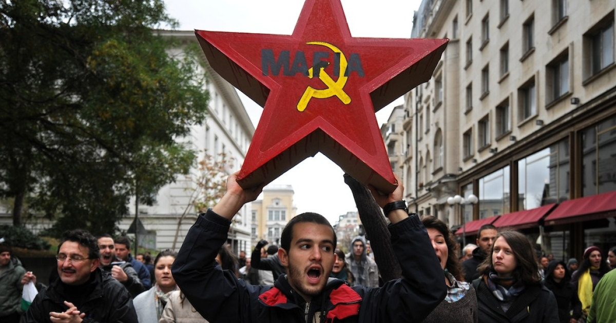 A student holds a red star, symbol of the former communist regime, during an anti-government protest in center of Sofia on November 15, 2013. The protest followed months of street tensions in the European Union's poorest country and came few days after students padlocked Sofia University demanding the resignation of Prime Minister Plamen Oresharski's embattled Socialist-backed government.</p>