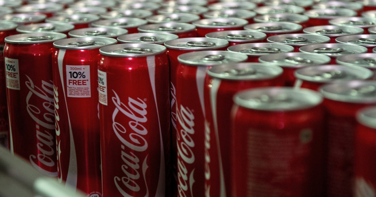 Coca Cola cans are seen on a production line at a bottling plant near New Delhi, India.</p>