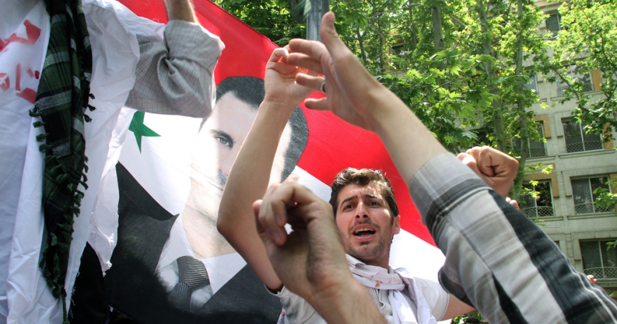Holding up the Syrian flag, Iranian and Syrian students attend an anti-Israeli demonstration in front of the United Nations offices in Tehran, on May 6, 2013, to condemn Israeli air strikes on targets near the Syrian capital Damascus.</p>