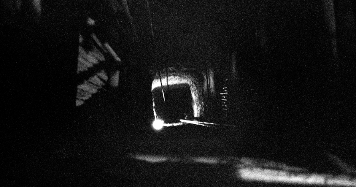 An active mine shaft at night. Miners work around the clock to meet increasing demand for domestic and international exportation.</p>