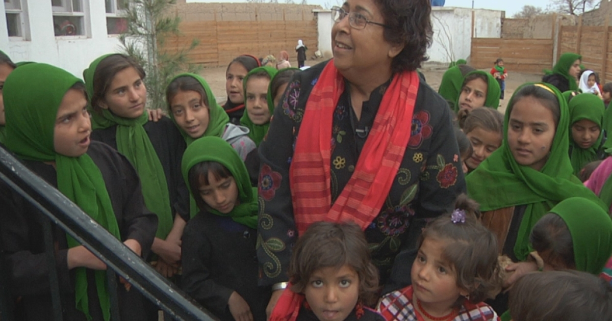 Razia Jan with students at her school in Kabul Province, Afghanistan</p>