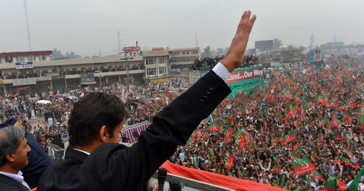 Imran Khan, Chairman of Pakistan Tehreek-e-Insaaf (PTI) party, gestures while addressing a protest rally in Peshawar on November 23, 2013.</p>
