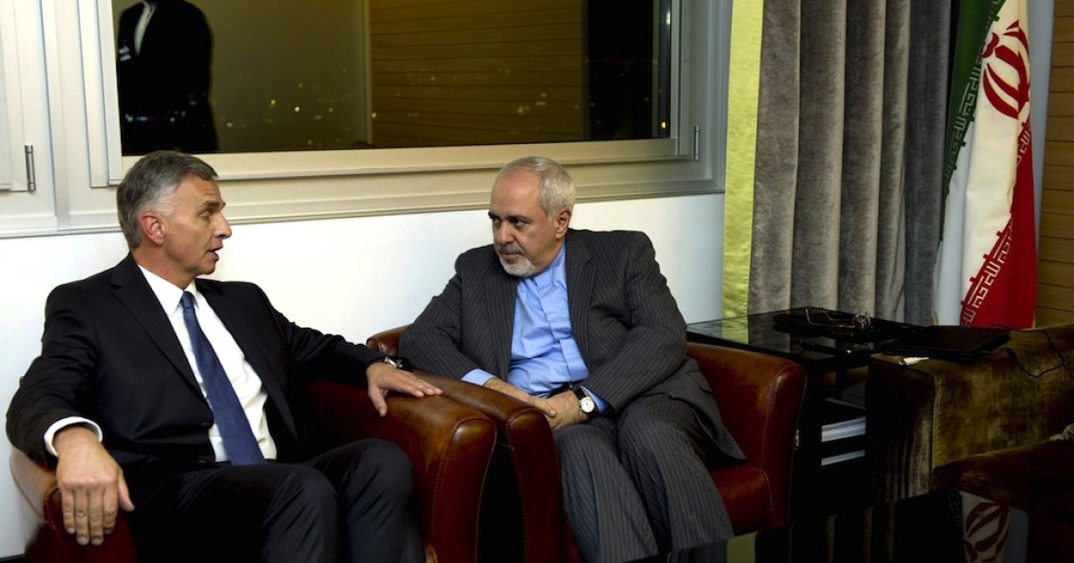 Switzerland's Foreign Minister Didier Burkhalter talks with Iranian Foreign Minister Mohammad Javad Zarif during a meeting at the Intercontinental Hotel prior to talks about Iran's nuclear program in Geneva on November 23, 2013.</p>