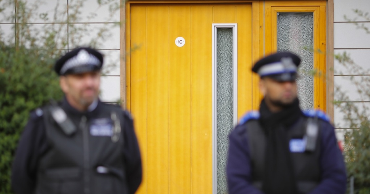 Police continue to stand guard for a second day outside a South London block of flats that is being investigated in connection with an alleged slavery case on November 24, 2013 in London, England.</p>