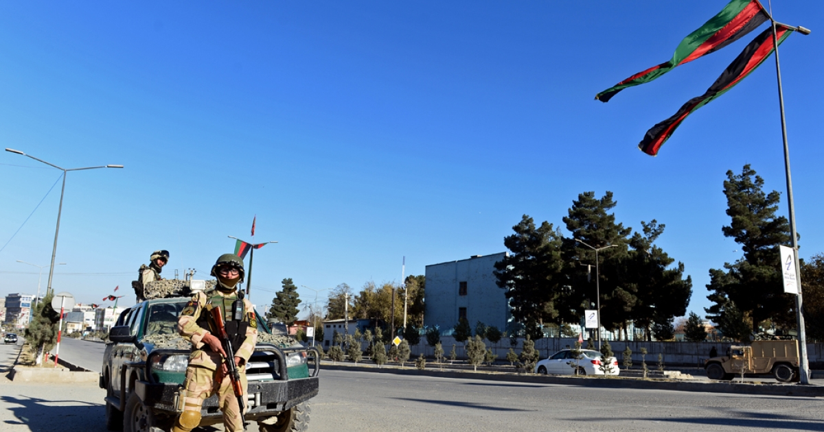 Afghan policemen looks on as they stand guard near the premises where the forthcoming Loya Jirga will be held in Kabul on November 19, 2013.</p>