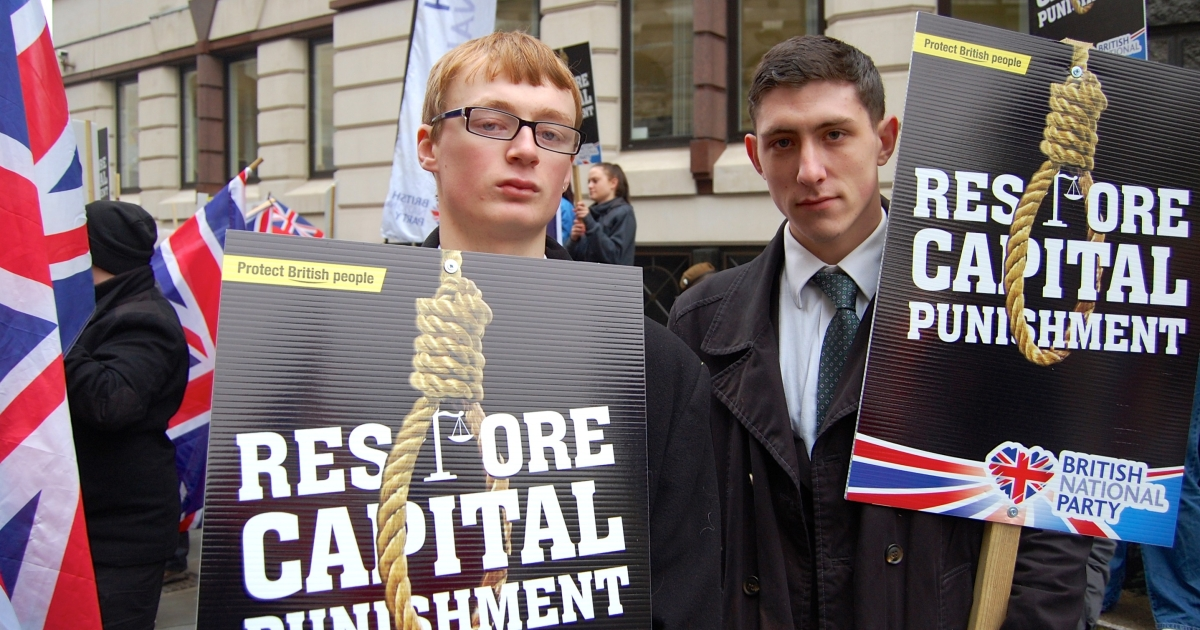 Kevin Layzell (L) and Mark Jones, both 19, protest on behalf of the British National Party.</p>