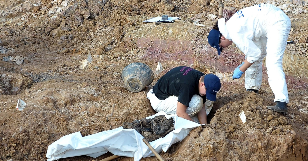 Forensic experts at a mass grave in western Bosnia last month search for human remains believed to have belonged to Muslims and Croats killed by Serb forces. The authorities are still searching for 1,200 people missing from the area.</p>