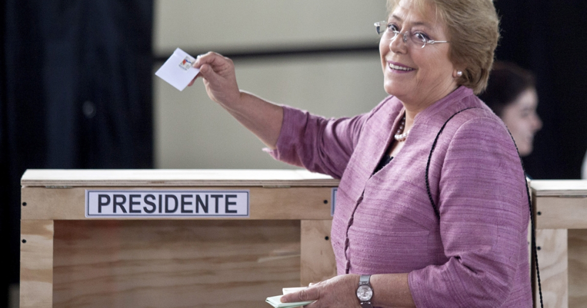 Michelle Bachelet, casting her vote in Chile's election Sunday, is widely expected to win back the presidency.</p>