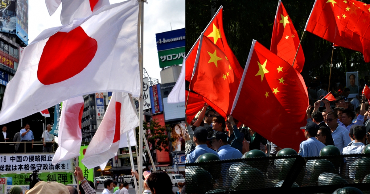 Japanese nationalists, on the left, and Chinese nationalists, on the right, protesting over the disputed islands in the East China Sea on September 18, 2012. Japan knows them as the Senkaku Islands and China calls them Diaoyu.</p>