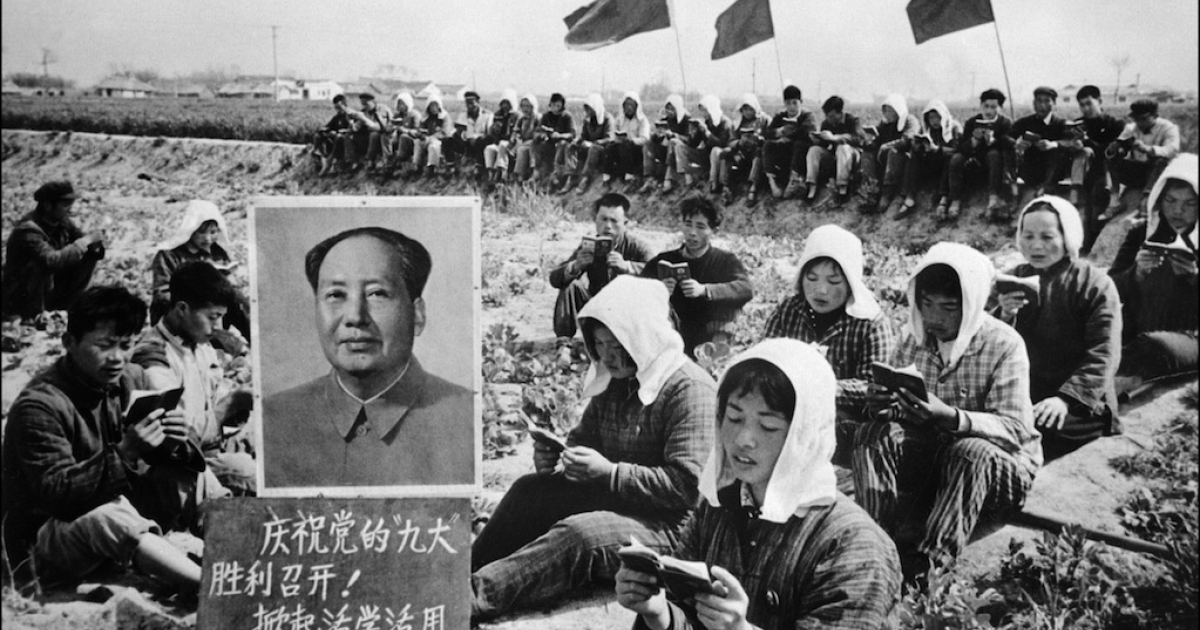 Picture released in 1969 by Chinese official news agency of Chinese peasants reading Mao's Little Red Book amid a photo of the Communist Leader. Forced confessions were common at the time. Some see echoes of the Cultural Revolution in recent