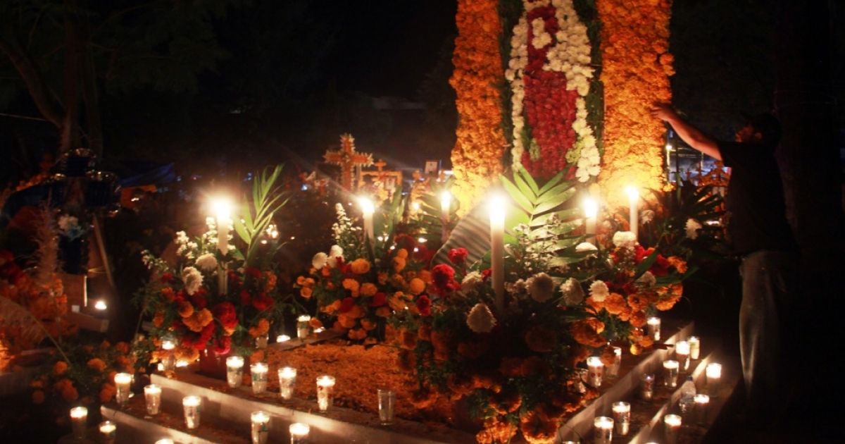 Flowers and candles adorn a cemetery in Tzintzuntzan, Michoacan state, Mexico.</p>