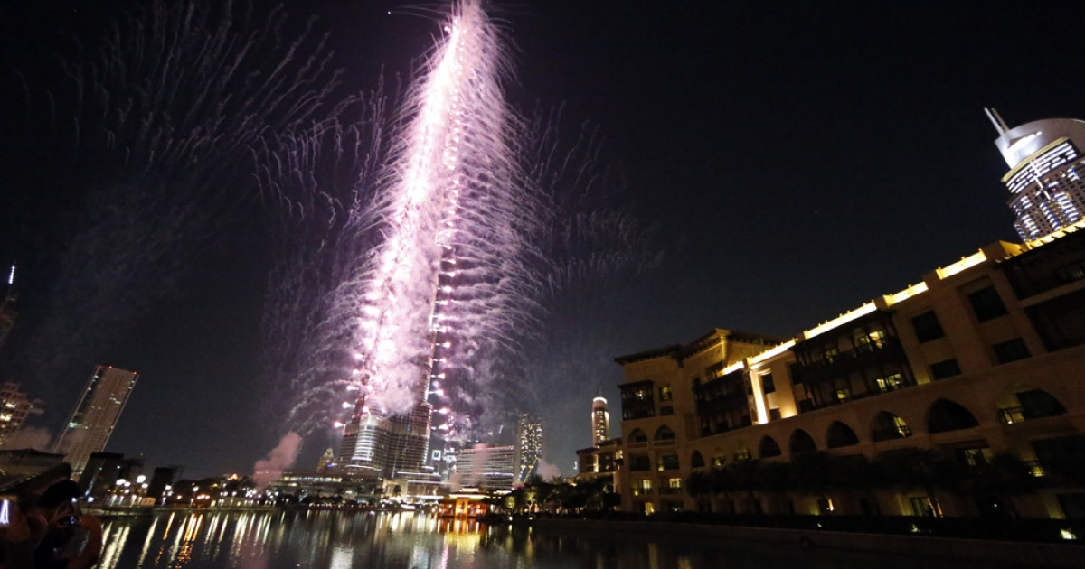 Fireworks illuminate the sky around Dubai's Burj Khalifa, the world's tallest tower, on November 27, 2013, after the Emirati city was chosen to host the World Expo 2020. The Gulf city state beat Russia's Ekaterinberg in the final round of voting to clinch a prestigious event credited with delivering a huge boost to tourism and business for its host city.</p>