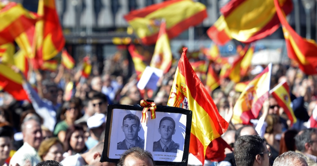 People hold Spanish flags and portraits of victims of terrorism at Plaza de Colon in Madrid on Oct. 27, 2013 during a protest against the European Court of Human Rights' ruling that could lead to the release of dozens of jailed ETA militants.</p>