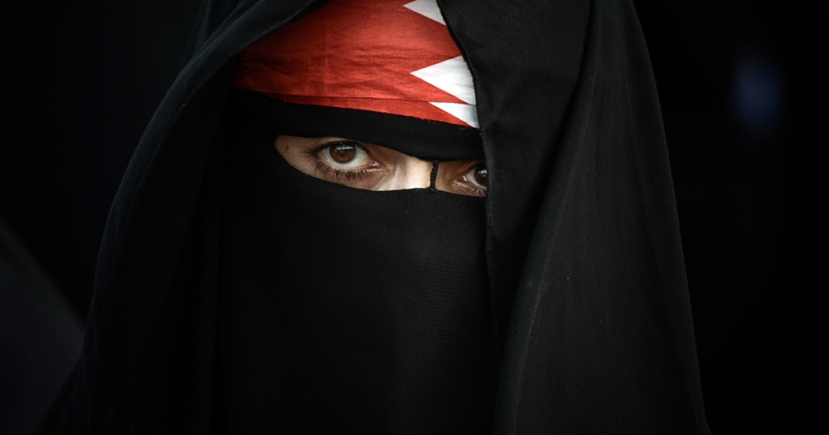 A Bahraini woman poses for a picture during an anti-government rally in the village of Abu Saiba on August 23, 2013.</p>