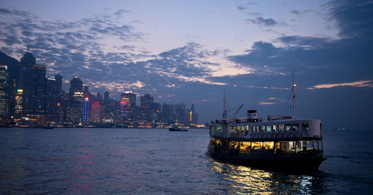 Commuters travel on the Star Ferry in Victoria Harbour from Kowloon to Hong Kong on Nov. 21, 2013.</p>
