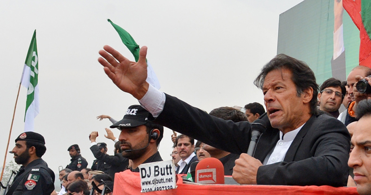 Imran Khan, Chairman of Pakistan Tehreek-e-Insaaf (PTI) party, addresses a protest rally in Peshawar on November 23, 2013.</p>