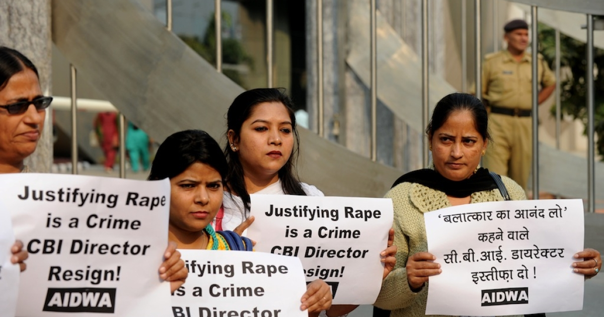 Indian women hold placards during a protest outside the headquarters of the Central Bureau of Investigation in New Delhi on Nov. 13, 2013, after the head of the CBI, Ranjit Sinha, used a rape analogy during a discussion about illegal sports betting.</p>