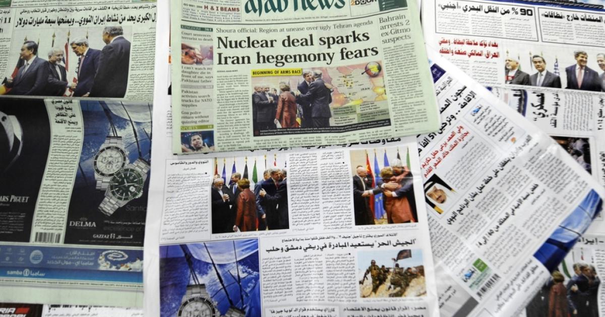 Saudi newspapers headlining an Iran agreement.</p>