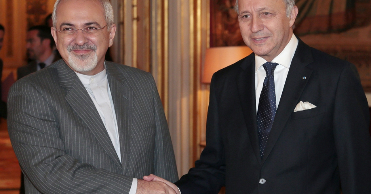 French Foreign Minister Laurent Fabius, right, welcomes his Iranian counterpart Mohammad Javad Zarif to the Quai d'Orsay Foreign ministry on November 5, 2013 in Paris.</p>