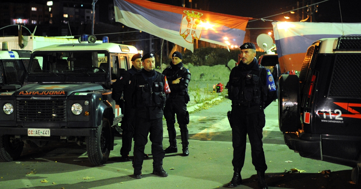 Italian carabinieri, part of the KFOR troops, stand guard on the main bridge over the Ibar river that separates the ethnically divided city of Kosovska Mitrovica on November 3, 2013. One woman was injured in an incident at a polling station in Serb-run part of Mitrovica, stormed by several masked extremists, who attacked voters and electoral commission members and destroyed ballot boxes, a Belgrade-backed Serb candidate for Mitrovica mayor, Krstimir Pantic, told reporters.</p>