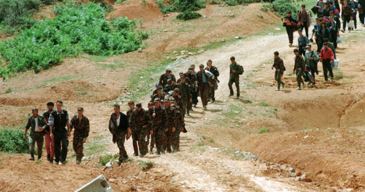 Kosovo Liberation Army (KAL) combatants arrive in Albania near Tropoje after crossing the border from Kosovo in 1989.</p>