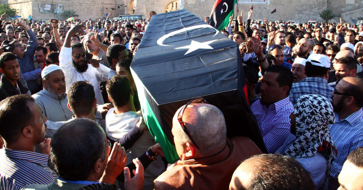 Mourners carry the coffin, draped in the Libyan flag, of one of the victims of a shootout the previous day at an anti-militia protest, Martyr's square, Tripoli, Nov. 16, 2013.</p>