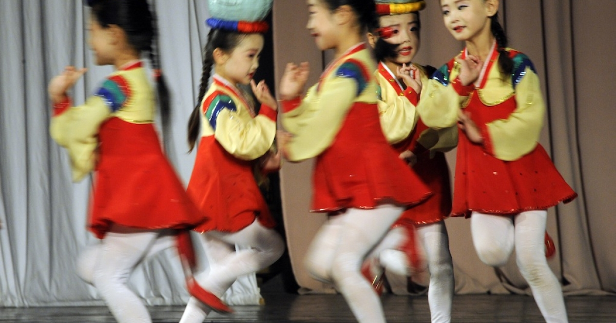 This photo taken on August 29, 2011 shows young performers entertaining foreign tourists in North Korea. Although Kim Jong Un's regime has made moves to attract tourists, it recently arrested an American veteran on a government-sponsored tour.</p>