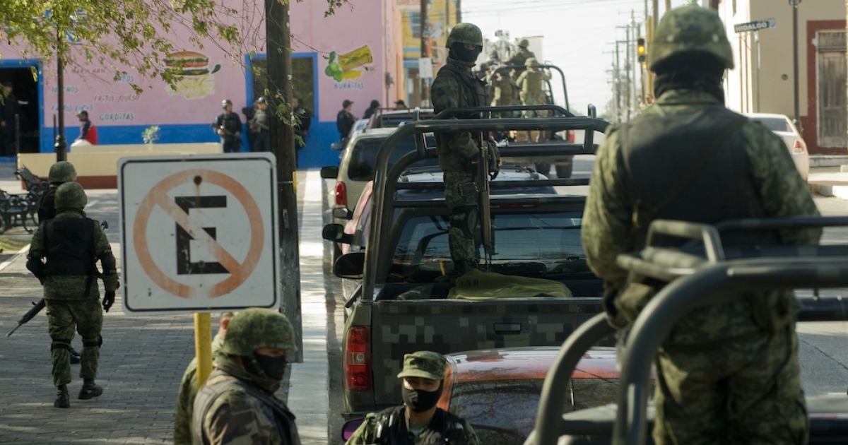 Mexican soldiers patrol the streets of Ciudad Mier in the northeastern state of Tamaulipas on Dec. 8, 2011.</p>