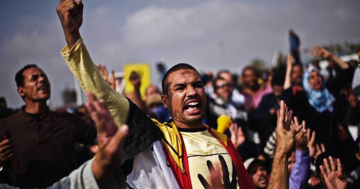 Supporters of ousted president Mohamed Morsi shout slogans outside the Police Academy where his trial is taking place on Nov. 4, 2013, in Cairo.</p>