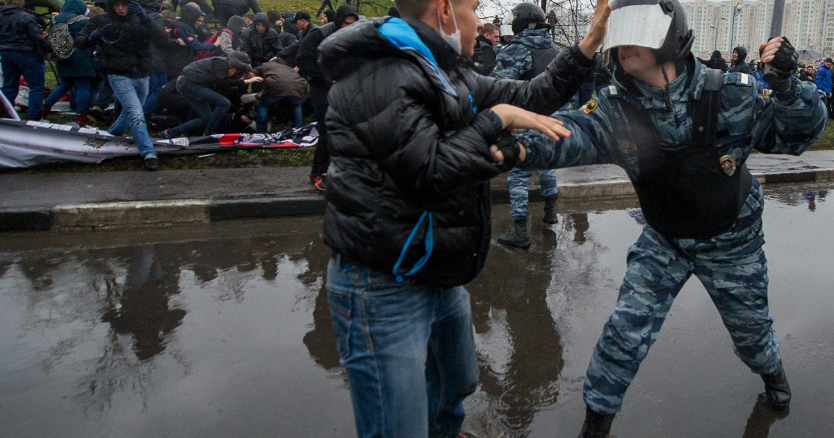 Nationalists clash with riot police during Moscow's