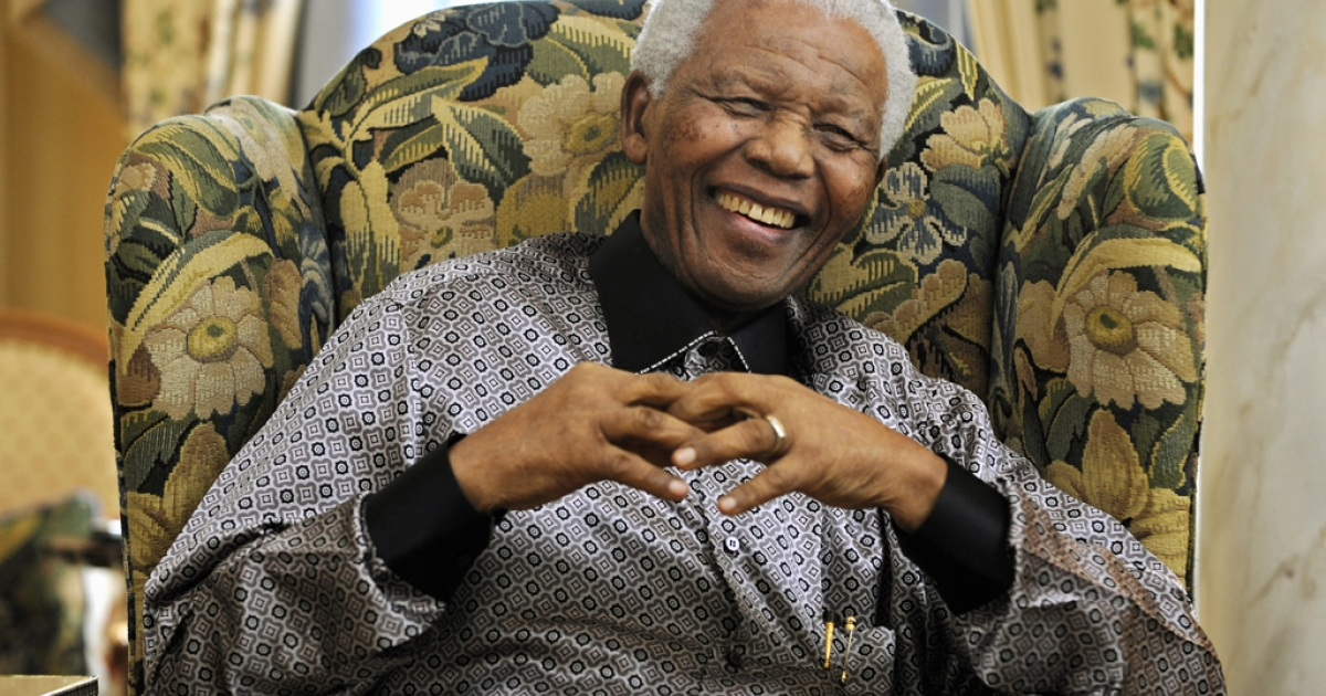 Former South African president Nelson Mandela is pictured during a meeting with Britain's Prime Minister Gordon Brown (not pictured) at his hotel, in central London, on June 24, 2008. Nelson Mandela arrived in Britain Monday June 23, 2008 ahead of a 90th birthday concert in his honour in London's Hyde Park. The three-hour gig on Friday, headlined by veteran rockers Queen alongside the likes of Razorlight and Simple Minds, will also support Mandela's 46664 campaign against HIV/AIDS. AFP PHOTO/Dylan Martinez/WPA POOL (Photo credit should read DYLAN MARTINEZ/AFP/Getty Images)</p>
