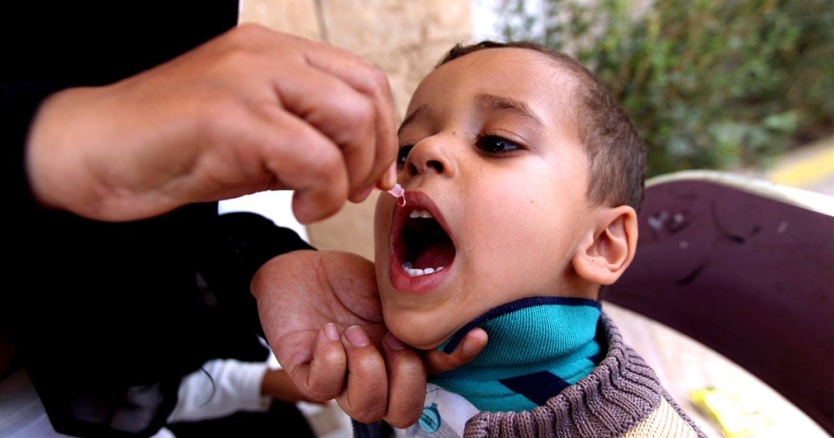 A Yemeni child receives a polio vaccine at a health center on June 2, 2013 in the Yemeni capital, Sanaa.</p>