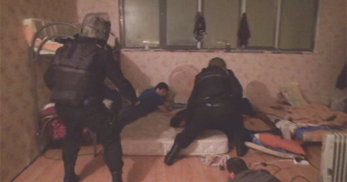 A screen grab from Russia's Life News shows police arresting alleged Islamic extremists in Moscow on November 26, 2013.</p>