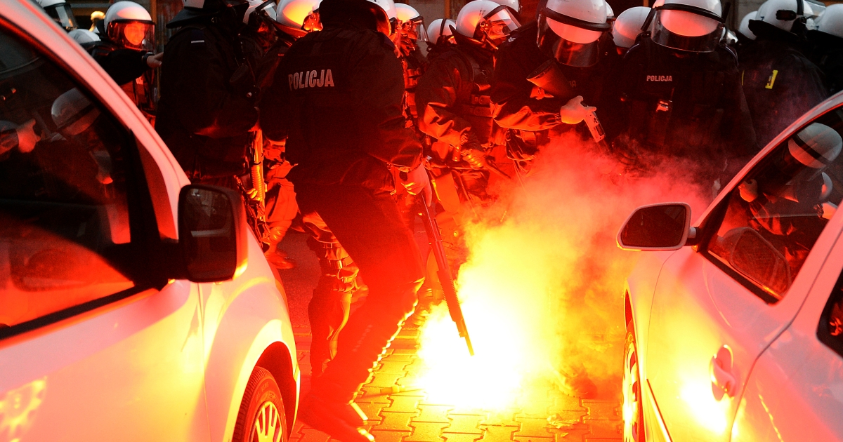 Police put out fires during clashes with far-right protesters during their annual march, which coincides with Poland's national Independence Day in Warsaw on November 11, 2013.</p>