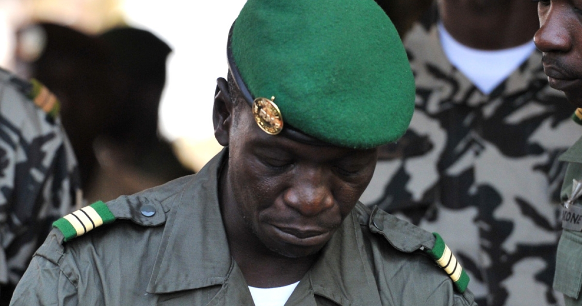 Then-Capt. Amadou Sanogo speaks to reporters on April 3, 2012 at Kati military camp near Bamako, Mali.</p>